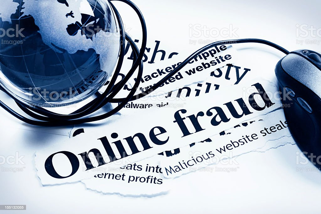 Glass world globe and computer mouse on Online Fraud headlines stock photo