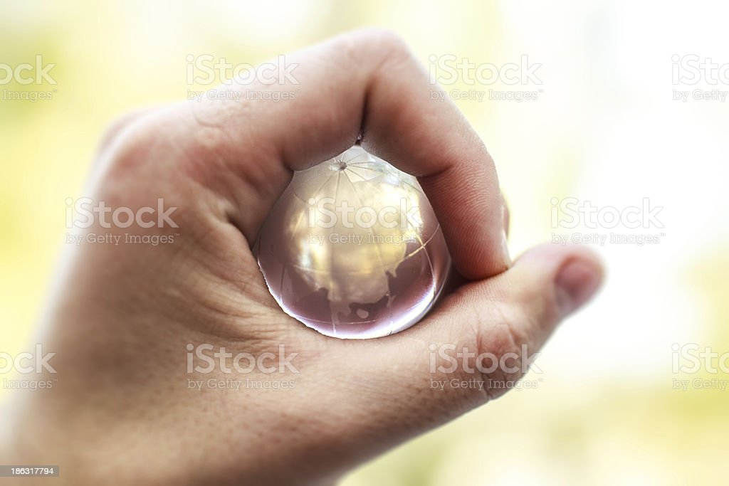 Glass world in your hand royalty-free stock photo
