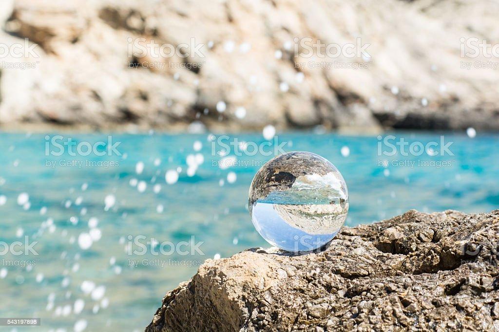 Glassball  at Mediterranean  Sea stock photo