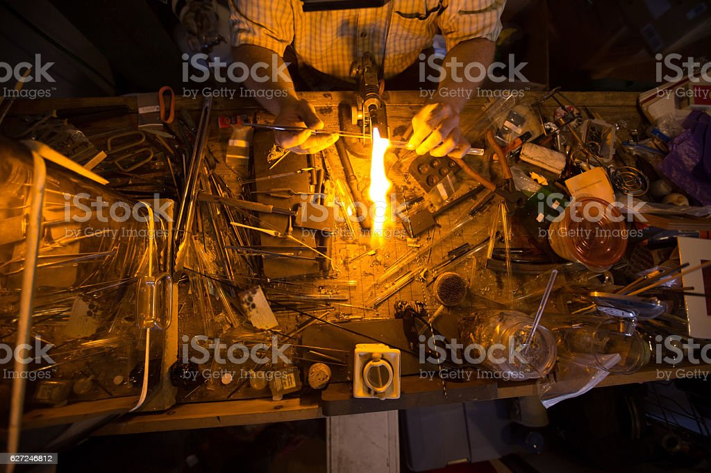 Glassblower doing torchwork stock photo