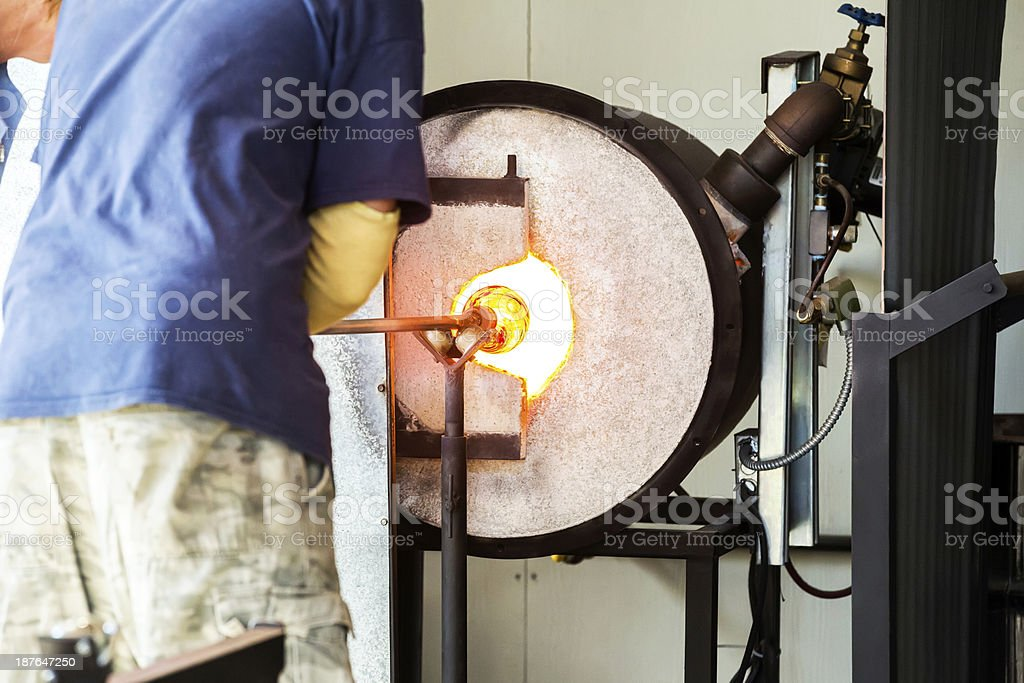 Glassblower working in Skagway, Alaska royalty-free stock photo