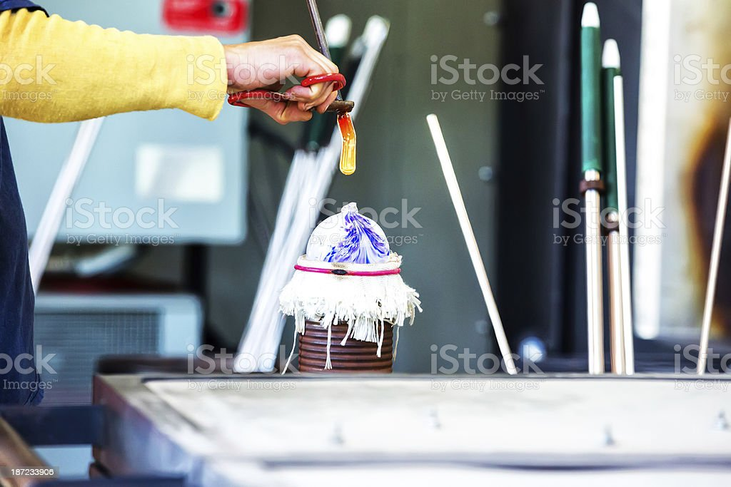 Glassblower working on an ornament. royalty-free stock photo
