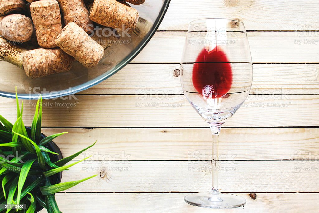 Glasse with red wine on a light wooden table stock photo