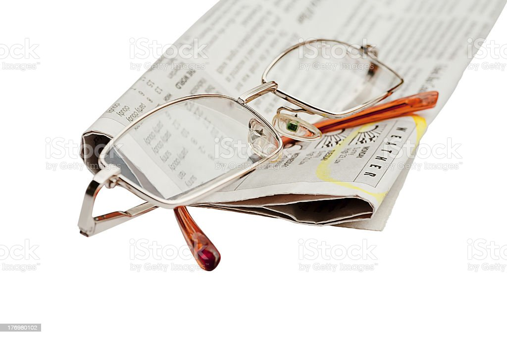 Glasses and a newspaper royalty-free stock photo