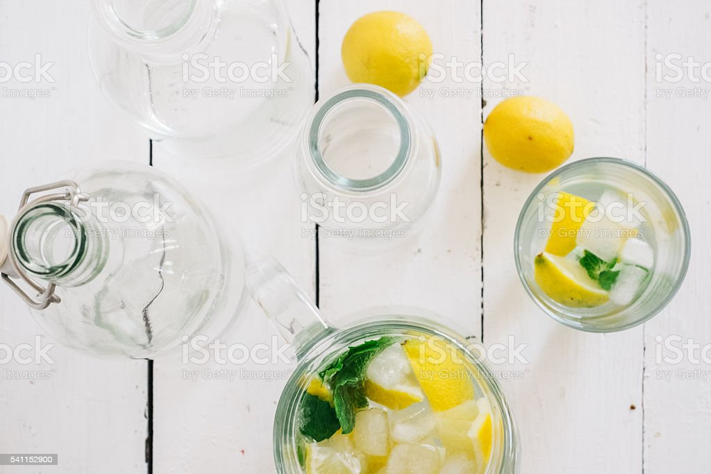 glasses and a pitcher with fresh mojito stock photo