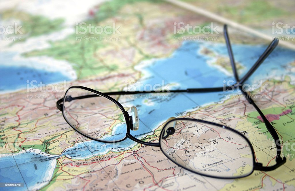 Glasses and atlas royalty-free stock photo