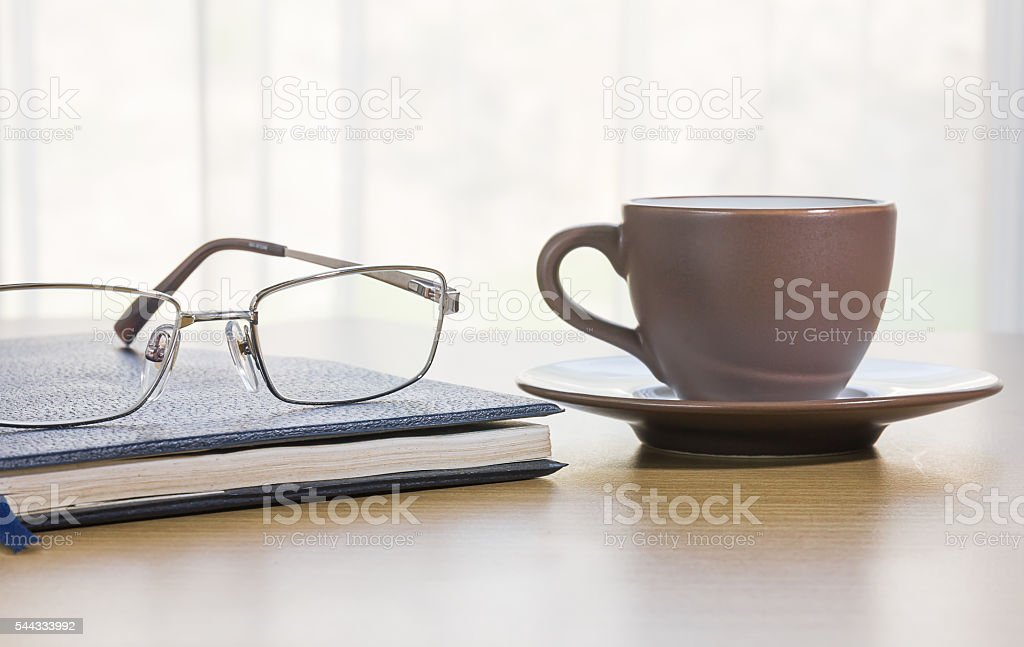 Glasses and book on the desk stock photo