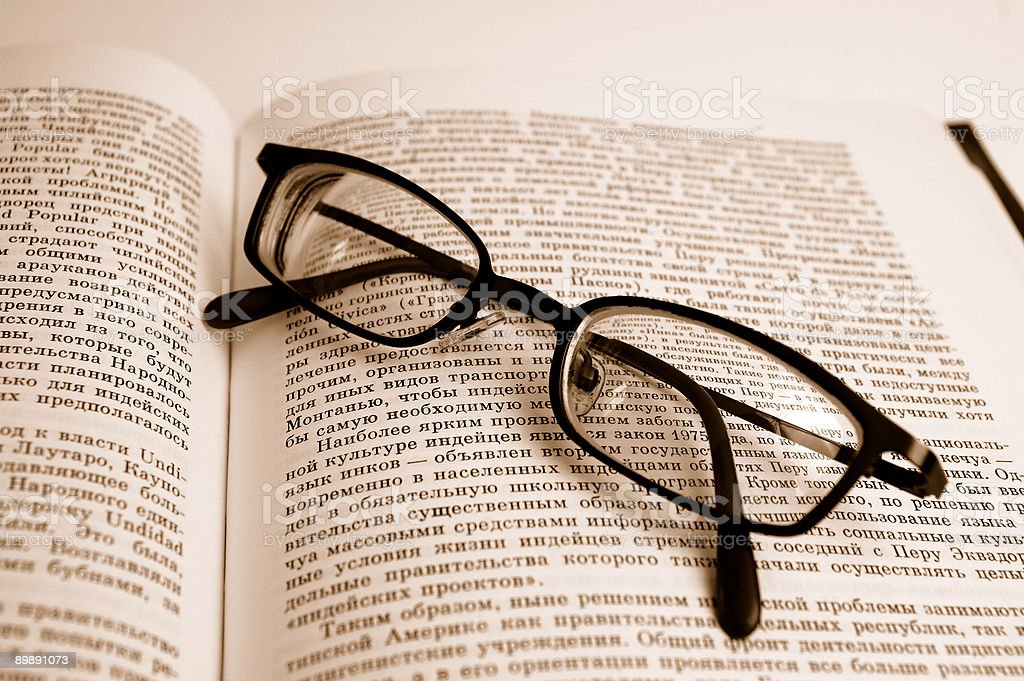 Glasses and book royalty-free stock photo