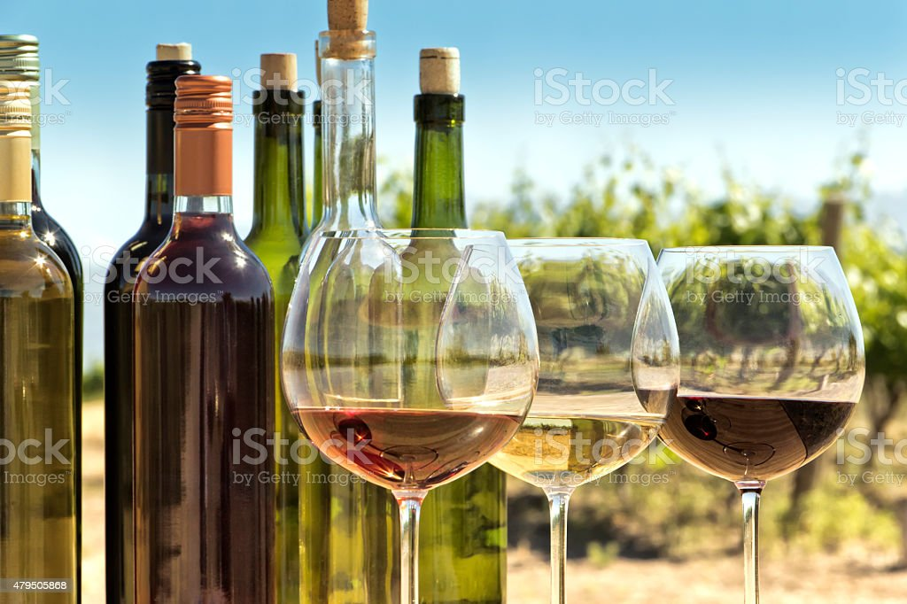 Glasses and bottles of wine stock photo