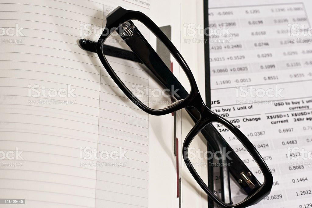 Glasses and financial documents stock photo
