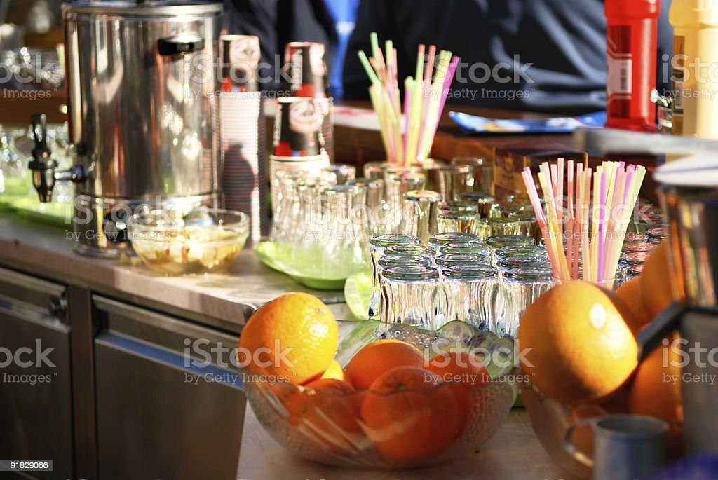 Glasses and fruit on the bar stock photo