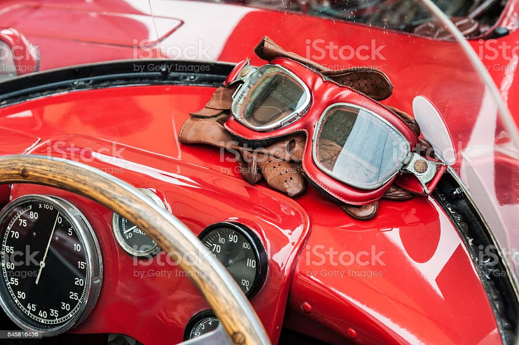 Glasses and gloves inside a vintage red car stock photo