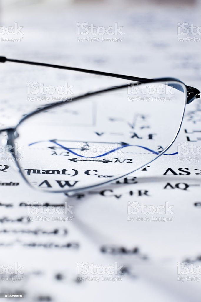 Glasses and Mathematical Equations royalty-free stock photo