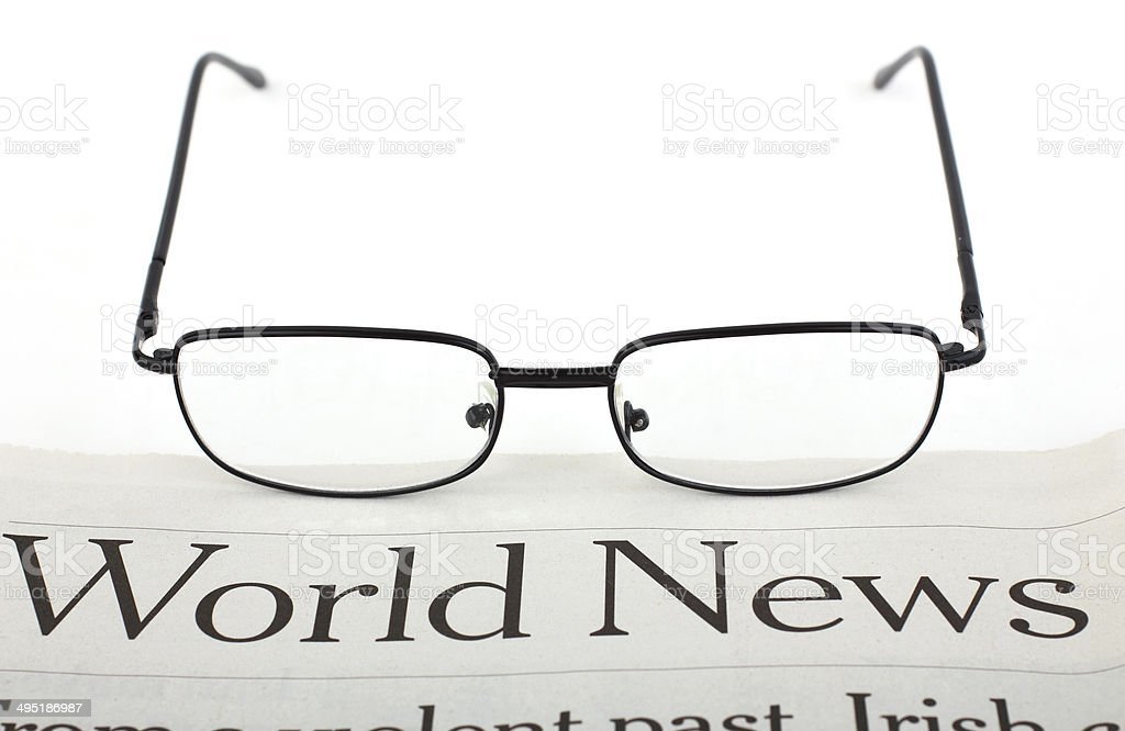 Glasses and newspaper royalty-free stock photo