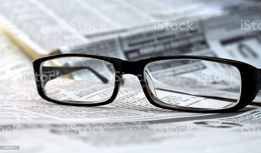 Glasses and Newspaper stock photo