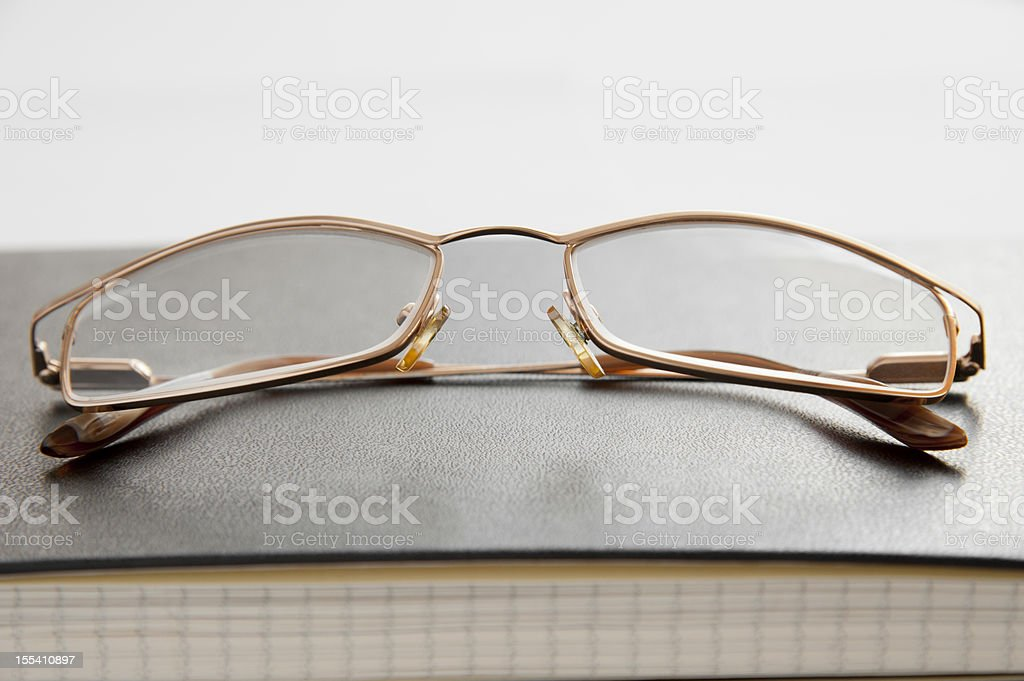Glasses and notebook royalty-free stock photo