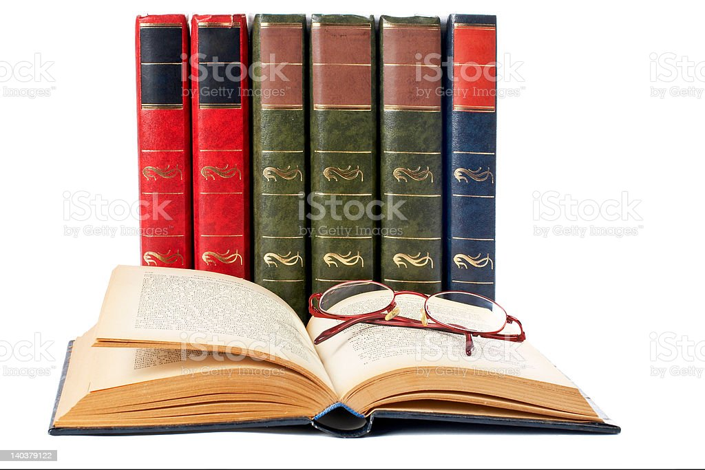 Glasses and open book royalty-free stock photo
