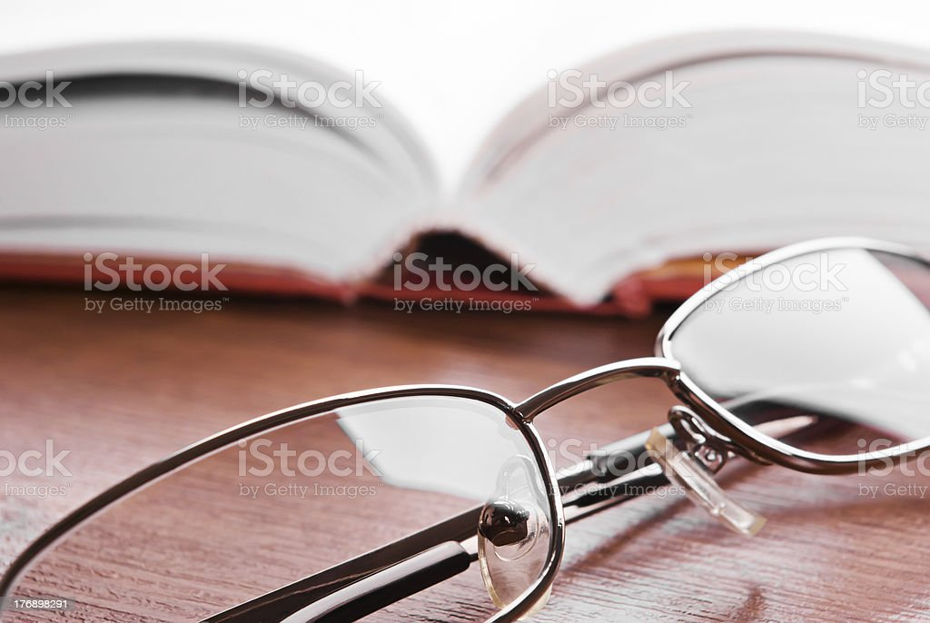 Glasses and open book stock photo