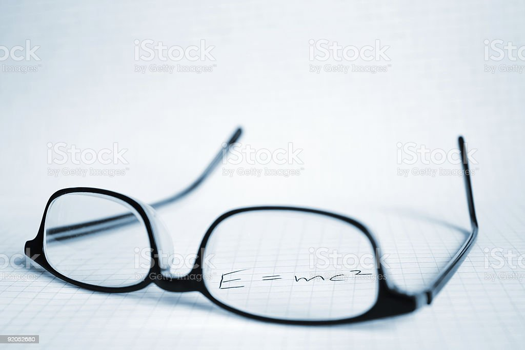 Glasses and paper with Albert Einstein's E=mc2 royalty-free stock photo