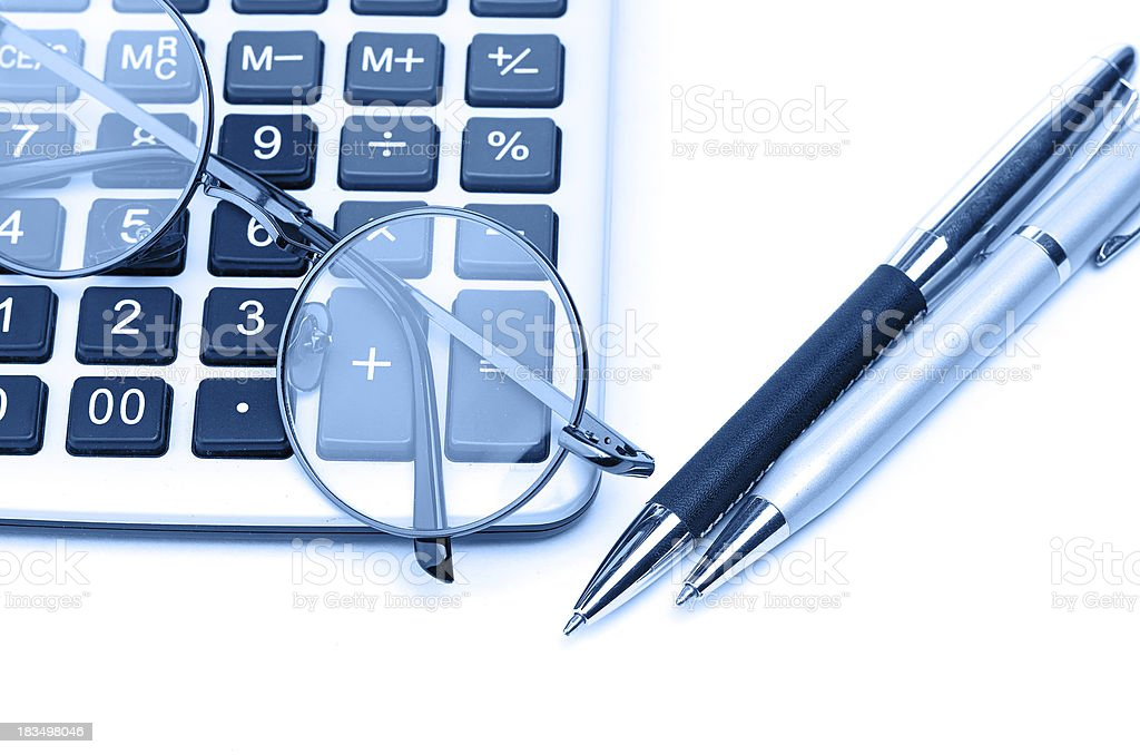glasses and pen on calculator royalty-free stock photo