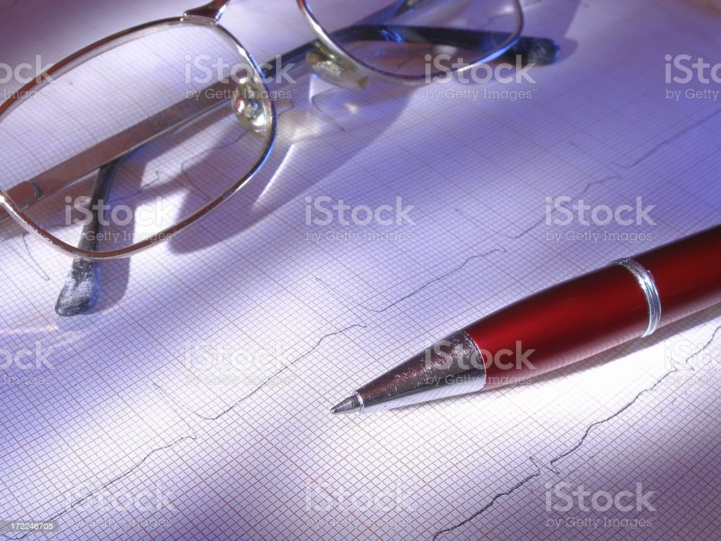 Glasses and pen on the ECG royalty-free stock photo