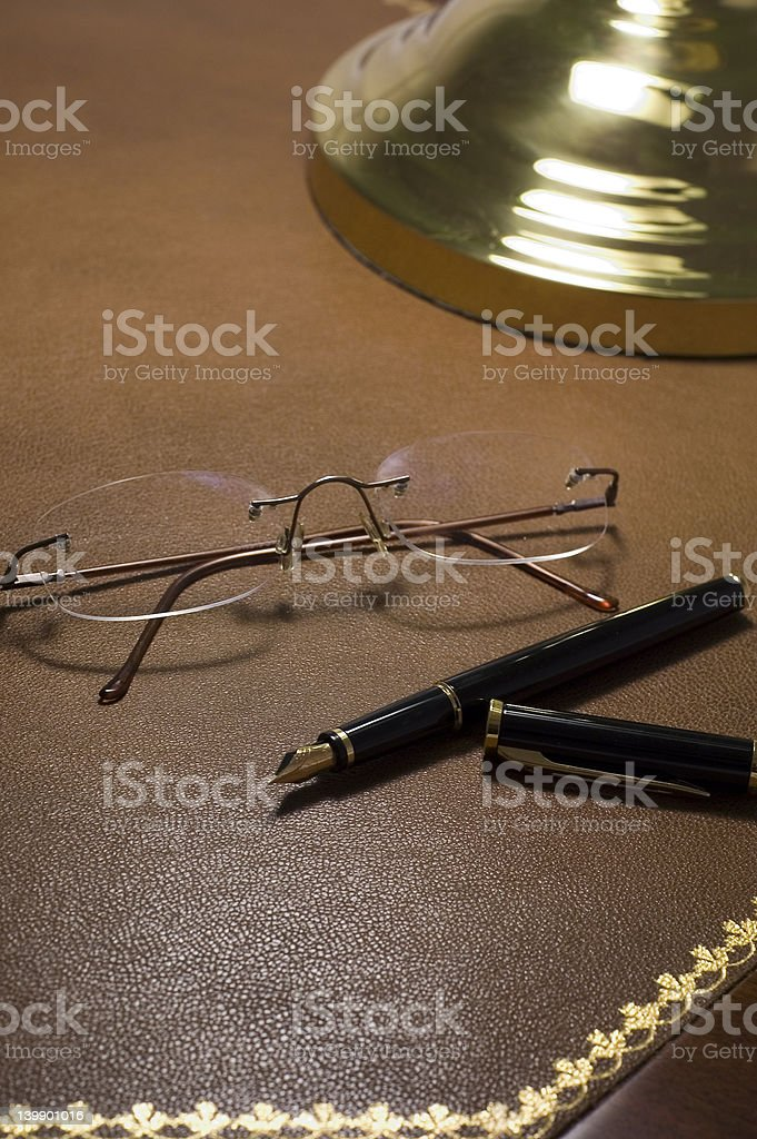 glasses and pen over desk royalty-free stock photo