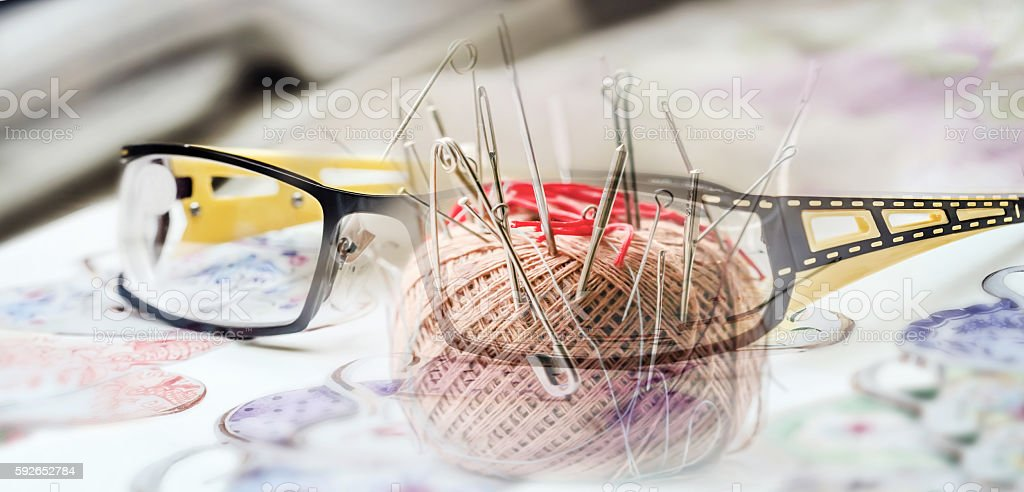 Glasses and pincushion stock photo