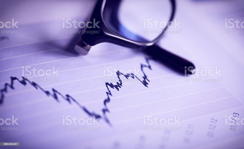 Glasses are laying on ashare index stock photo