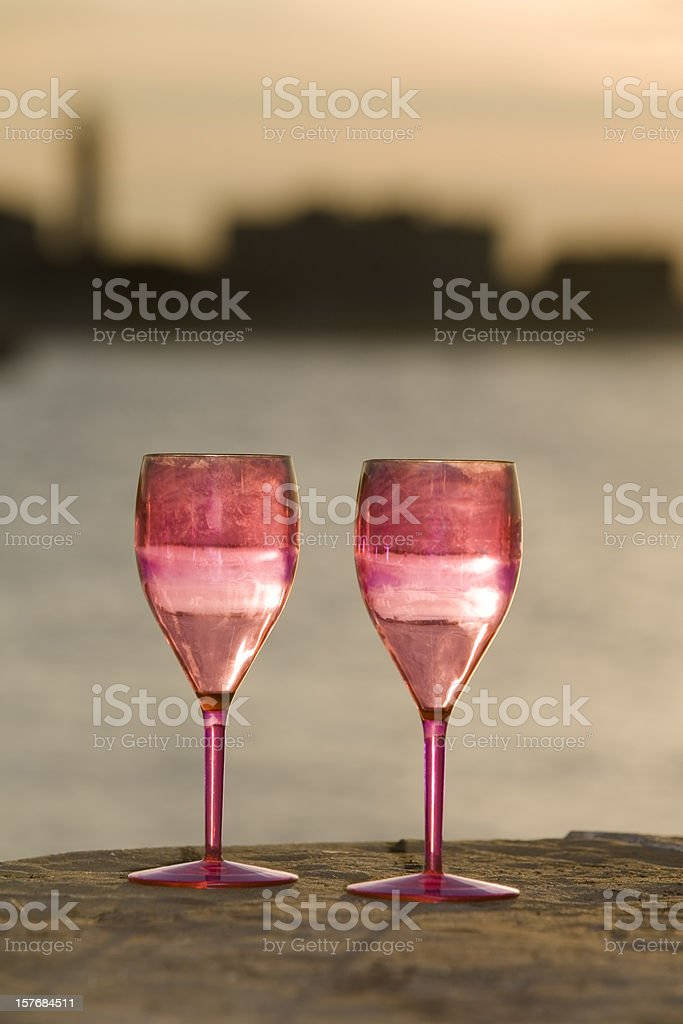 Glasses at sunset royalty-free stock photo