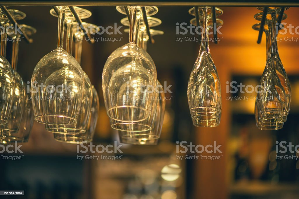 Glasses champagne hangs above the bar counter in the bar. stock photo