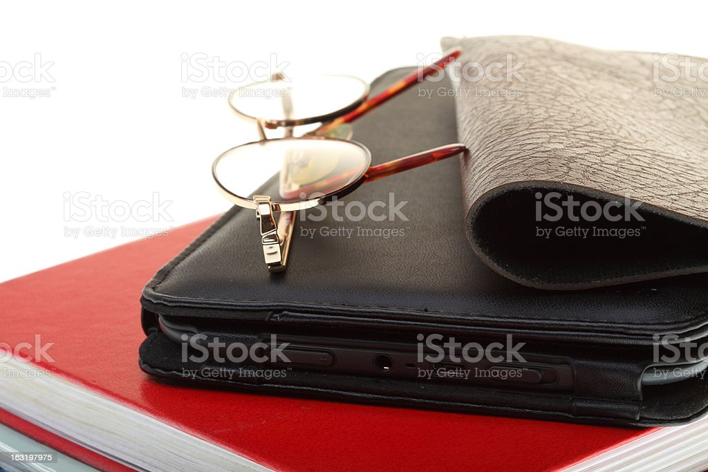 glasses eBook reader pile of books, isolated on white royalty-free stock photo