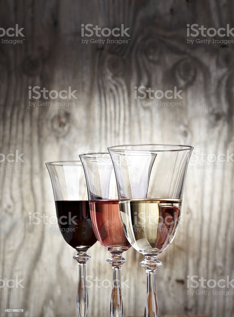 Glasses filed with wine stock photo