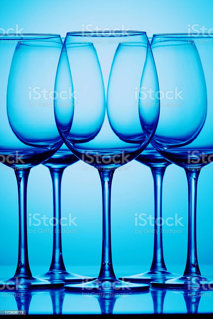 Glasses in blue royalty-free stock photo