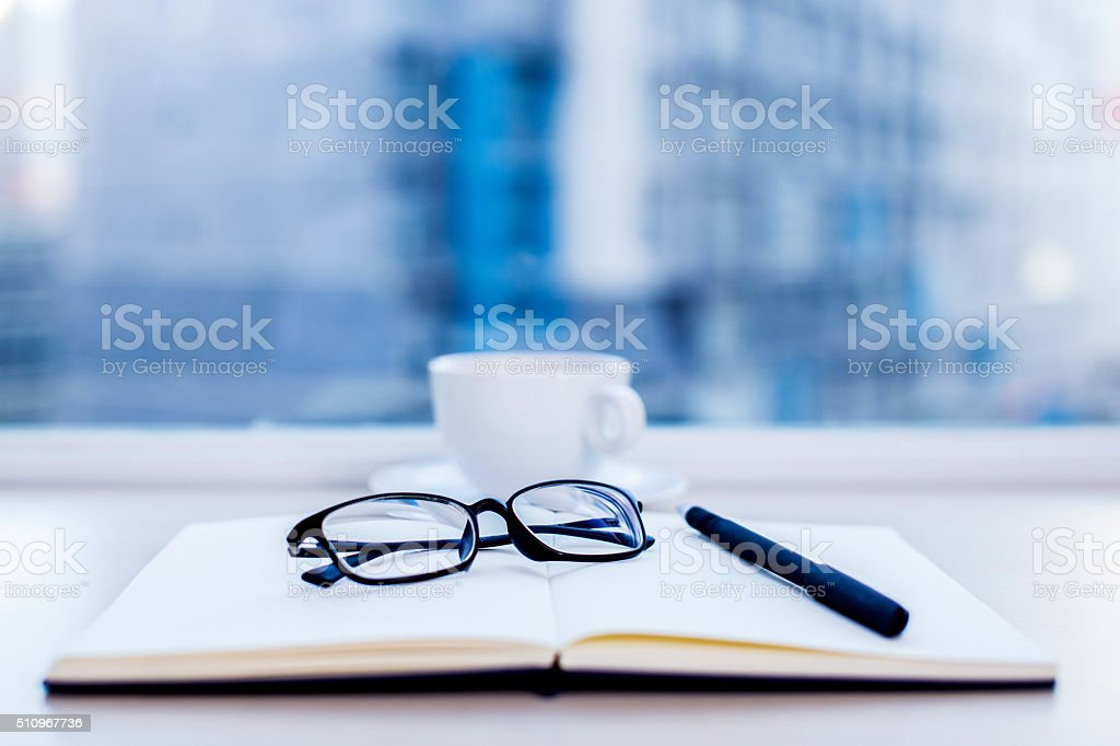 Glasses in the focus, workspace, laptop stock photo