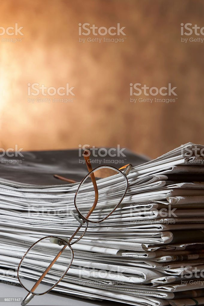 Glasses & Newspapers royalty-free stock photo