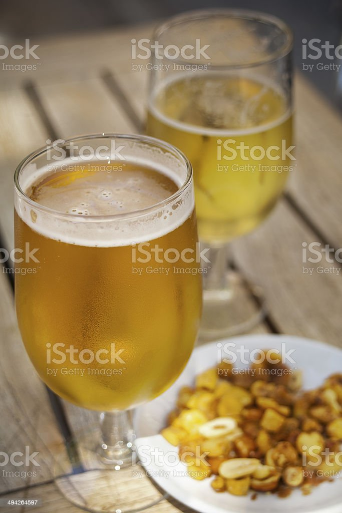Glasses of beer and toasted corn royalty-free stock photo