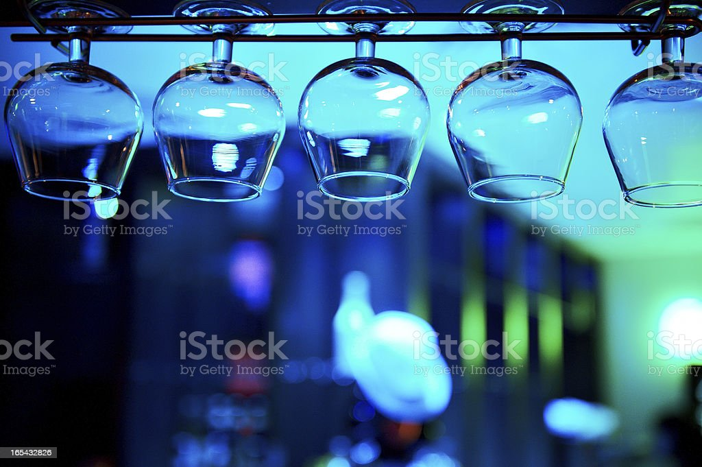 Glasses of brandy over the bar royalty-free stock photo