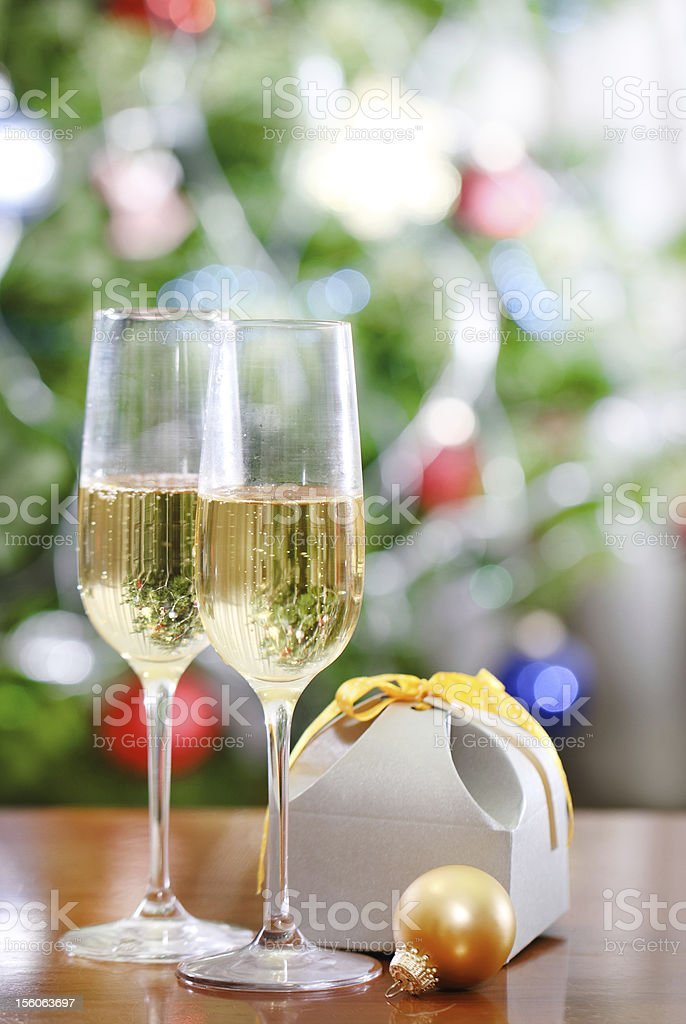 Glasses of champagne and Christmas gift royalty-free stock photo