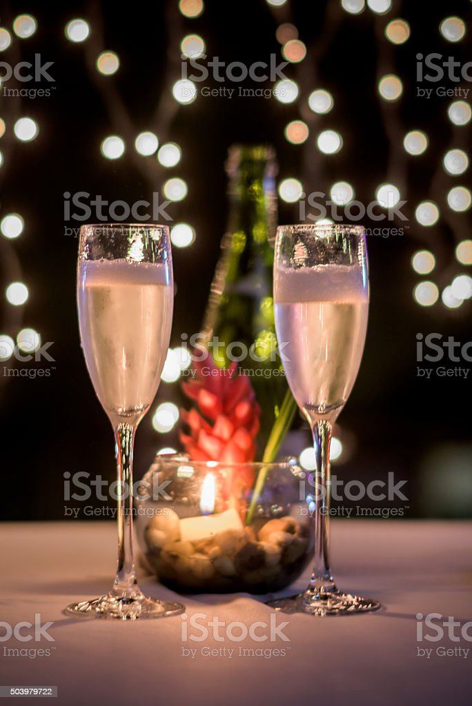 Glasses of champagne at a romantic dinner stock photo