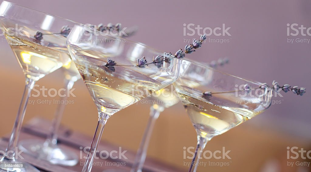 Glasses of champagne decorated with lavender stock photo