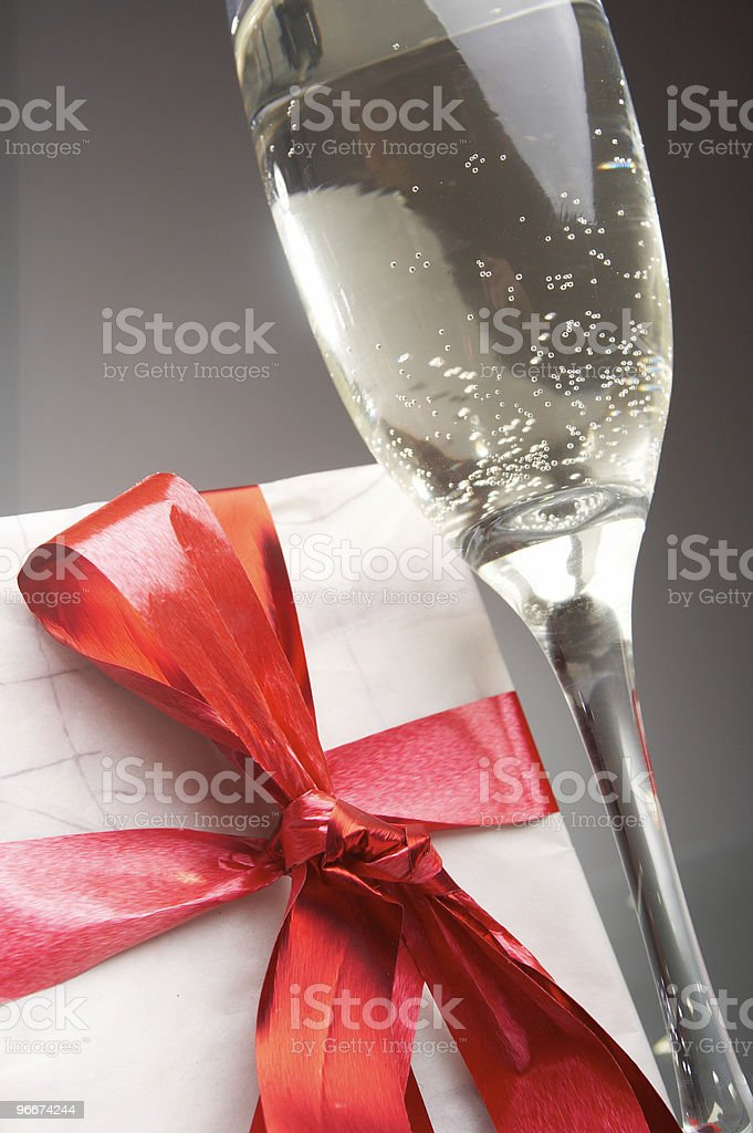 Glasses of champagne, gifts with red tapes and bows royalty-free stock photo