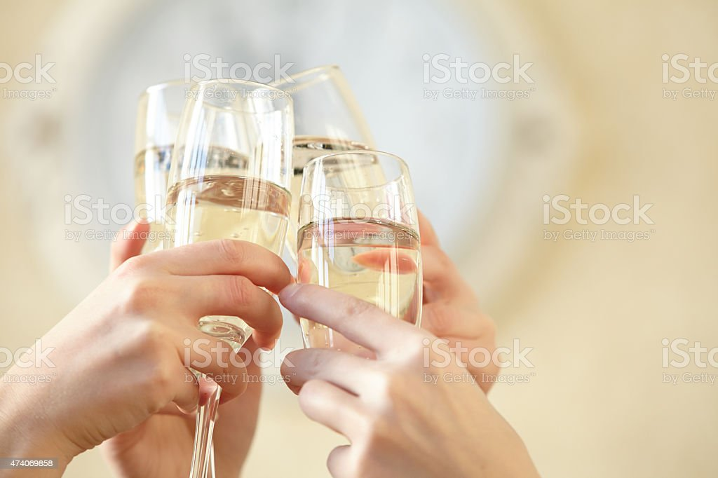 Glasses of champagne in female hands on a party stock photo