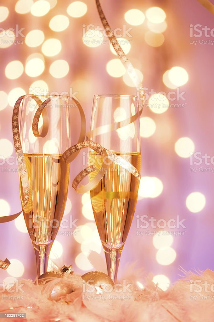 Glasses of champagne with bokeh effect light in background. royalty-free stock photo