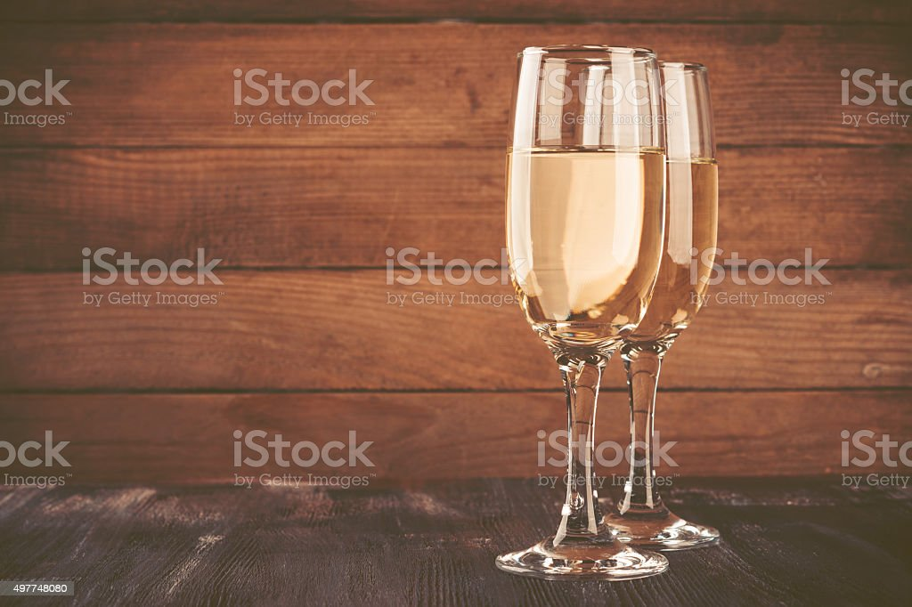 Glasses of champagne wooden background stock photo