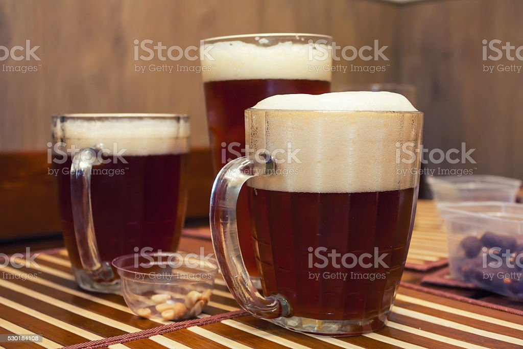Glasses of dark beer in a pub royalty-free stock photo