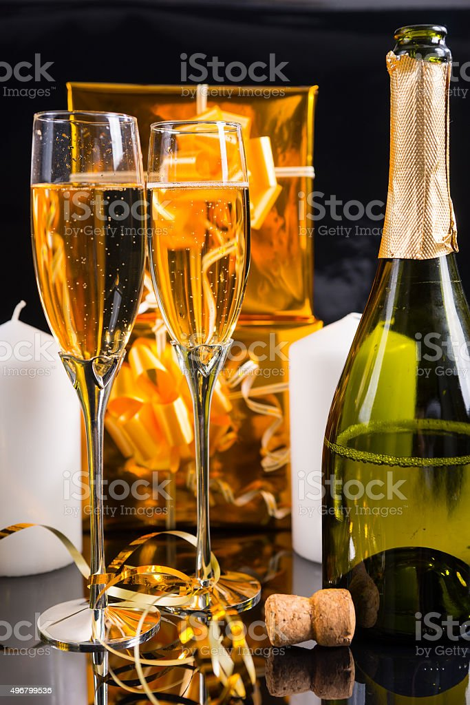 Glasses of Festive Champagne with Uncorked Bottle stock photo