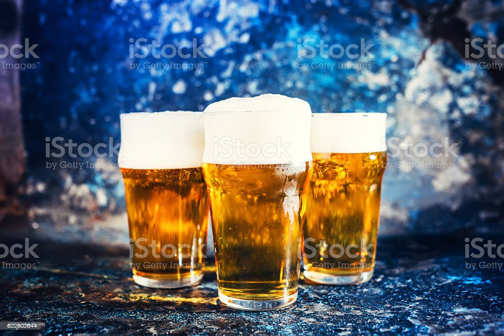 Glasses of lager beer, light beers served cold at pub stock photo