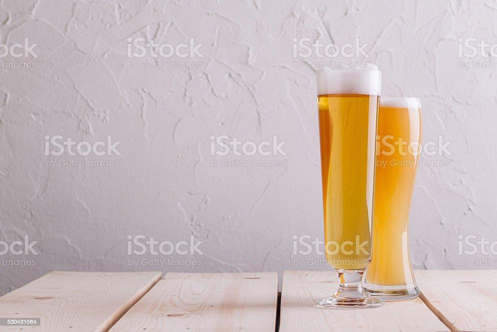 Glasses of light beer stock photo