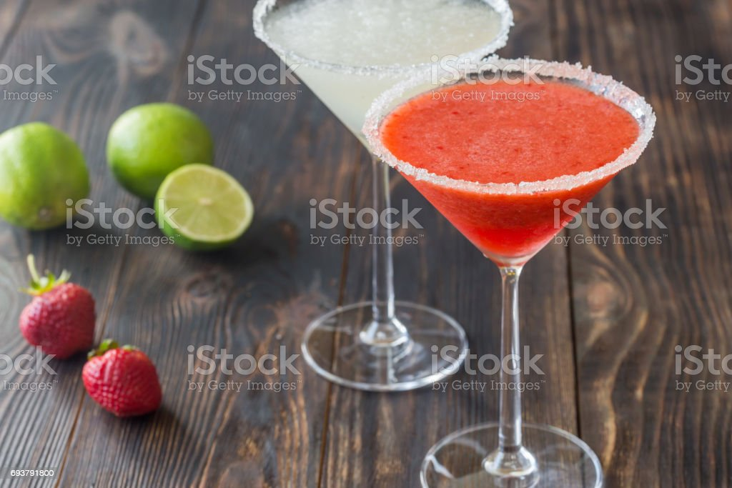 Glasses of lime and strawberry margarita cocktail stock photo