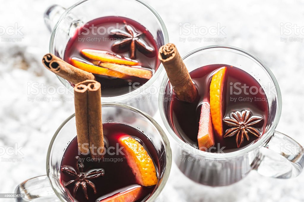 Glasses of mulled wine in snow stock photo